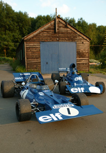 001 and 006 in front of the woodshed in which they were built