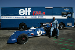 John Delane poses with his Tyrrells, 002 and the Tyrrell Transporter