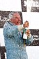 John Delane celebrates his 2011 Historic Formula One Championship on the podiam at Jarama, Spain
